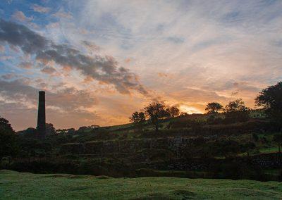 Sunrise over old mine buildings